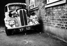 Old car with graffiti, brick wall, urban style Royalty Free Stock Photo