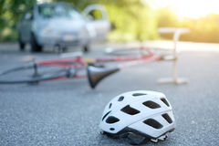 Broken bicycle on the asphalt after incident Royalty Free Stock Photos