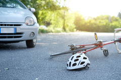 Broken bicycle on the asphalt after incident. Broken bicycle on the asphalt after car crash incident royalty free stock photos