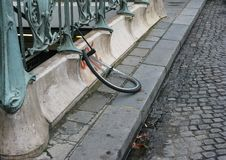 A broken bicycle wheel is all that`s left Paris, France stock images
