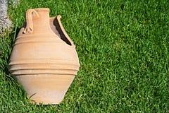 Broken big ceramic pot closeup on a grass Stock Photos
