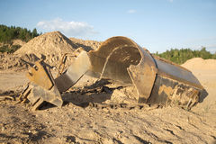 Broken big heavy bucket lies on sand on summer day Royalty Free Stock Images