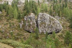 Broken big stone at the foot of Odle group in Dolomites Stock Photo