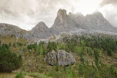 Broken big stone at the foot of Odle group in Dolomites Stock Photography