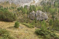 Broken big stone at the foot of Odle group in Dolomites Stock Photos
