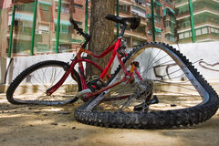 Broken bike. Close up photo of a bicycle totally broken in the floor Royalty Free Stock Photos