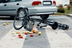 A broken bike on a pedestrian crossing after a collision with a. Car royalty free stock photo