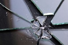 Broken glass with small pieces lies on a black surface royalty free stock photo