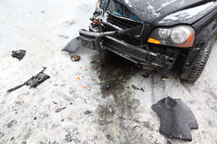 Broken black car on road in winter Stock Image