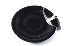 Broken black dish Royalty Free Stock Image