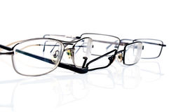 Broken black eyeglasses Royalty Free Stock Image