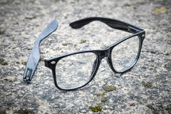 Broken black glasses Royalty Free Stock Photo