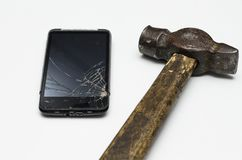 Broken black mobile phone. With hummer stock photography