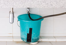 Broken blue house stock photos royalty free stock images for Leaky pipe carries more water