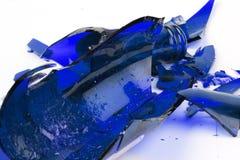 Broken blue glass. On white royalty free stock photo