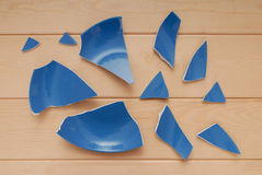 Broken blue plate Stock Images
