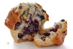 Broken blueberry muffin Stock Images