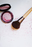 Broken blush with make up brush Royalty Free Stock Photography