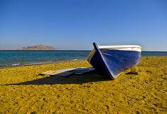 Broken boat on a deserted beach Stock Images