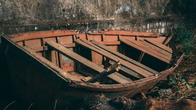 Broken Boat on a roadside stock photography