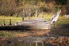 Broken boat on the shore. Broken old rotten boat on the beach Royalty Free Stock Photo