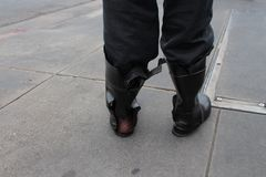 The broken boots. Broken boots walking in the street of San Francisco USA Stock Photography