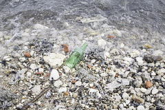 Broken bottle beach Royalty Free Stock Photos