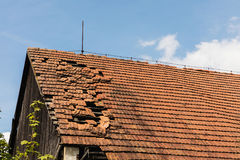 Broken brick bags on the roof of a cottage stock photos