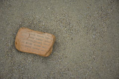 A broken brick on the beach. At krabi Stock Photography