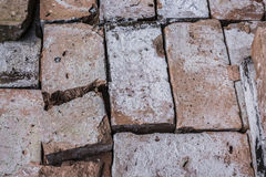Broken brick. In pile of old, used bricks from dismantled wall stock photography