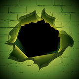 Broken brick wall. Torn hole at the brick wall background Royalty Free Stock Photography