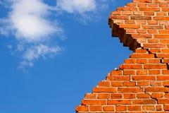 Broken brick wall against the sky. Broken brick wall against the blue sky Royalty Free Stock Image