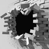 Broken brick wall with explosion cracked hole Royalty Free Stock Photography