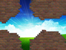Broken brick wall and grass field Royalty Free Stock Images