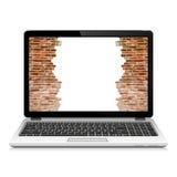 Broken brick wall on laptop screen Stock Photos