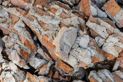 Broken brick. Brick wall, part of a house being demolished royalty free stock photos