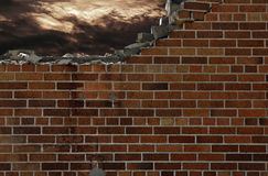 Broken brick wall with storm clouds Stock Photography