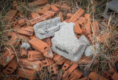 Broken bricks on ground. Broken bricks on red bricks on ground Stock Photography