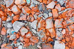 Broken bricks. Broken red bricks, stone texture stock photo