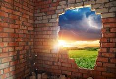 Broken bricks wal and landscape Royalty Free Stock Image
