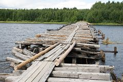 Broken bridge. An old broken bridge on a river in Karelia, Russia Stock Photography