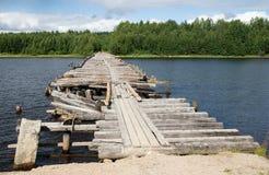 Broken bridge. An old broken bridge on a river in Karelia, Russia Stock Image