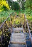 Broken bridge. Broken iron bridge with missing planks Royalty Free Stock Images