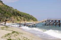 Broken bridge on beach Royalty Free Stock Image