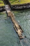 Broken bridge near the water Royalty Free Stock Photos