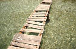 A broken bridge over crystalline water Royalty Free Stock Photography