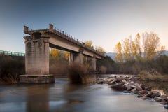 Broken bridge over a river Stock Image