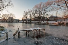 Broken bridge in the winter. The broken bridge became covered froze in ice in the winter and became covered by snow Royalty Free Stock Images