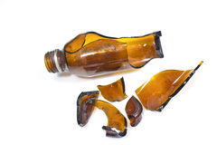 Broken brown bottle Stock Photos