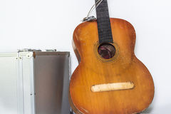 Broken brown classical guitar with detached bridge from body  in white background Royalty Free Stock Image